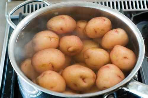 Boiling fresh harvest potatoes